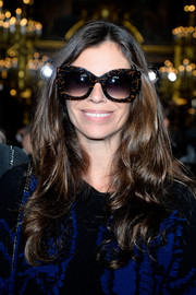 Christina Pitanguy accessorized with a pair of mottled sunnies that were almost half as big as her face.