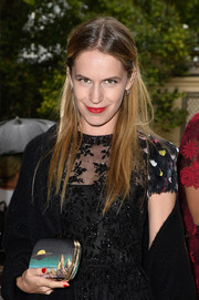 Eugenie Niarchos attended the Valentino Couture fashion show carrying a UFO-print clutch.