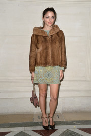 Sofia Sanchez Barrenechea completed her outfit with a pair of retro-chic bronze T-strap pumps.