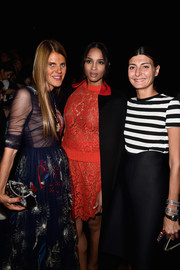 Giovanna Battaglia attended the Valentino fashion show wearing layers of diamond bracelets.