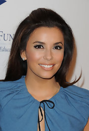 Eva Longoria attended the 2011 Stars Gala wearing dramatic eye makeup and soft, peachy-beige lipstick with a hint of shimmer.