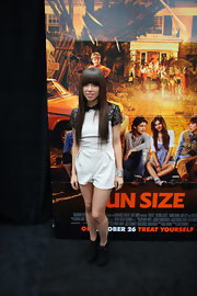 Carly Rae Jepsen kept her look cute when she paired black wedge booties with her lacy romper.