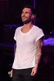 Maroon 5 frontman Levine has an elaborate sleeve tattoo on his left arm.