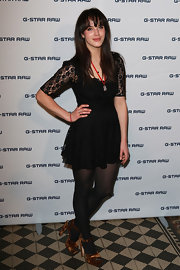 The lace sleeves on Jessica Brown-Findlay's little black dress kicked this whole look up a notch.