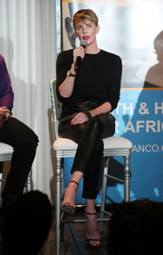 Charlize Theron kept it super simple in a black crewneck sweater and matching leather pants at the GEANCO Foundation Hollywood Gala.