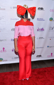 Sia cut a striking figure in a pink and red button-down shirt while attending the GEMS' Love Revolution Gala.