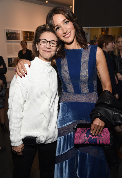 Jennifer Beals paired a snakeskin frame clutch with a lace and velvet dress for the Generation Wealth event.
