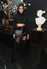 Chanel Iman sealed off her sexy-edgy attire with black velvet over-the-knee boots.