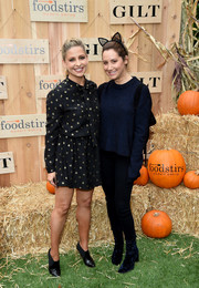 Ashley Tisdale attended the Gilt & Foodstirs Exclusive Cupcake Kit celebration dressed down in a loose blue sweater and black jeans.