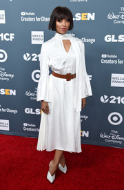 Kat Graham complemented her dress with a pair of white mules.