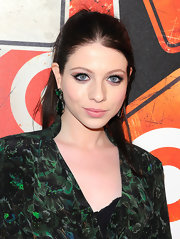 Michelle Trachtenberg paired her printed frock with dangling emerald green earrings.