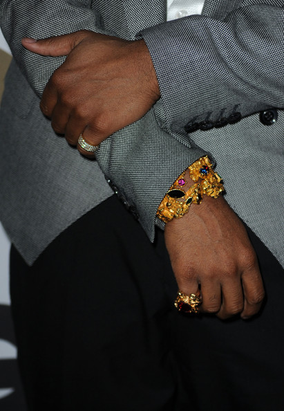 Brandon paired his grey blazer with a sparkling gemstone bracelet and matching ring.