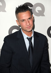 Mike wears a wide dotted tie with his pinstripe suit for the GQ party in LA.