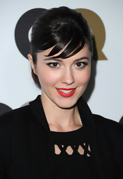 Mary offset her sexy red lips with a raven french twist. Short side-swept bangs offset her look.