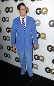 Johnny showed off his spunky side in a baby blue suit complete with a striped tie.