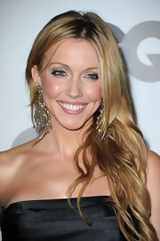 Katie Cassidy added instant glam to her look with gold and crystal chandelier earrings.