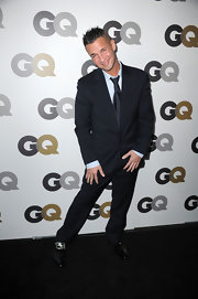 Mike looks dapper in a pinstripe men's suit at the GQ party in Los Angeles.