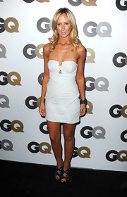 Lady Victoria donned strappy metallic heels with a mini white strapless dress. Gold curls and a major tan complete the look.