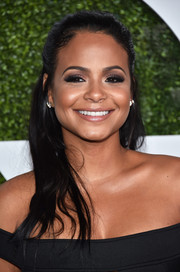 Christina Milian contrasted her sweet 'do with a sexy, smoky eye.