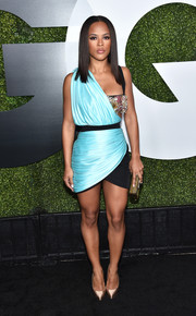 Serayah McNeill finished off her outfit with gold satin pumps by Casadei.