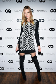 Andreja Pejic attended the GQ Gentlemen's Fund cocktail reception wearing a black-and-white geometric-patterned sweater dress.
