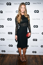 Nina Agdal injected a splash of color with a red snakeskin tube clutch.