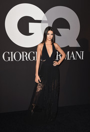 Kendall Jenner flaunted plenty of skin at the GQ and Giorgio Armani Grammy after-party in an Elie Saab deep-V halter gown with a sheer skirt and lace cutouts on the waist.
