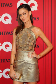 Nicole Trunfio's nude tube clutch and gold mini dress at the GQ Men of the Year Awards were a fab pairing.