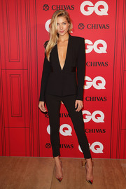Jessica Hart teamed gold cap-toe pumps with her pantsuit for a totally fierce look.