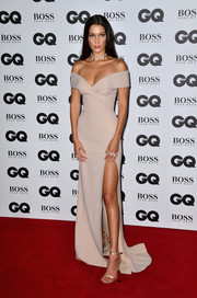 Bella Hadid was all about timeless elegance in a high-slit nude off-the-shoulder gown by Hugo Boss at the GQ Men of the Year Awards.