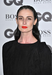 Erin O'Connor wore her hair slicked down at the top and subtly wavy at the back during the GQ Men of the Year Awards.