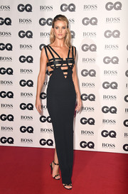 Rosie Huntington-Whiteley teamed her dress with studded black heels, also by Versace.