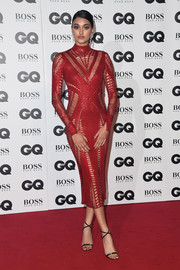 Neelam Gill flaunted her gorgeous figure in a body-con red cutout dress by Julien Macdonald at the 2018 GQ Men of the Year Awards.