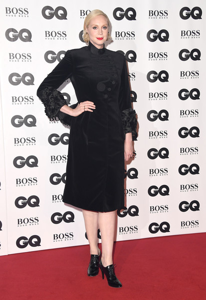 Gwendoline Christie was vintage-chic in a black coat dress with ruffled cuffs at the 2018 GQ Men of the Year Awards.
