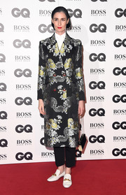 Erin O'Connor finished off her ensemble with a pair of embellished loafers.