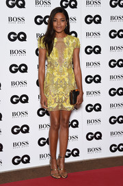 Naomie Harris dazzled at the GQ Men of the Year Awards in this heavily embellished yellow mesh mini dress by Julien Macdonald.