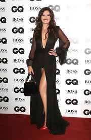 Daisy Lowe flashed some panties in a black evening dress with a dangerously high slit when she attended the GQ Men of the Year Awards.