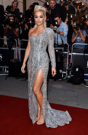 Rita Ora looked downright dazzling in an ultra-glam beaded silver one-shoulder gown by Zuhair Murad Couture during the GQ Men of the Year Awards.