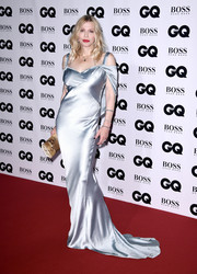 Courtney Love chose a tan snakeskin print clutch to finish off her look.