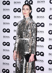 Erin O'Connor punctuated her metallic look with a simple black leather clutch by Charlotte Olympia at the GQ Men of the Year Awards.