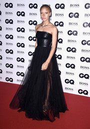 Adwoa Aboah was goth-glam in a strapless black Boss gown with a leather bodice and a sheer tulle skirt at the GQ Men of the Year Awards.