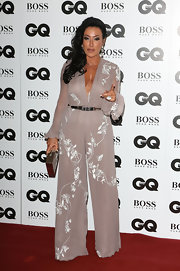 Nancy Dell'Olio looked alluring on the red carpet in a gray jumpsuit with a plunging neckline at the GQ Men of the Year Awards.