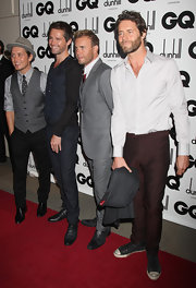 Howard Donald showed an eclectic sense of style with his white button-down, brown slacks, and sneaks.
