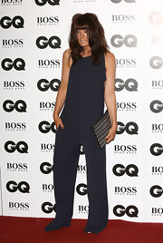 Claudia Winkleman hit the GQ Men of the Year Awards red carpet wearing a navy jumpsuit that looked a little too long.