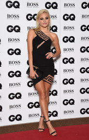 Pixie Lott complemented her dress with a black croc-embossed envelope clutch.