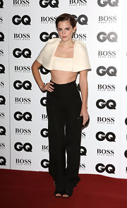 Emma Watson oozed an ultra-modern vibe in a funky white crop top during the GQ Men of the Year Awards.