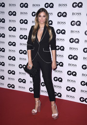 Amber Le Bon gave her suit some feminine appeal with a pair of sky-high pink sandals.