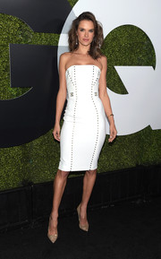 Alessandra Ambrosio oozed edgy elegance in a studded, strapless white dress by Versace at the GQ Men of the Year party.