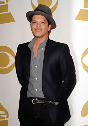 Bruno paired his black jeans and button down shirt with a pin striped blazer.