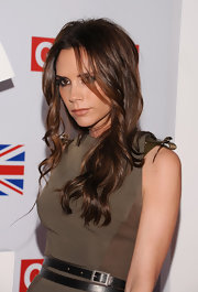 Victoria Beckham attended a reception honoring British nominees of the 2012 Academy Awards wearing her long hair in loose, casually tousled waves.